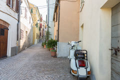 Old Vespa scooter on italian alley Stock Images