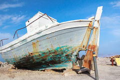 Old veteran ruined fishing boat in beach shore on Greek Kos island Mastihari bay Stock Images