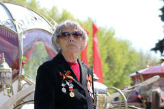 An old veteran takes part at Immortal regiment on 9 May, 2016 in Ulyanovsk, Russia stock images