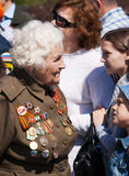 Old veteran woman on victory day Royalty Free Stock Image