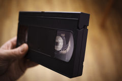 Old VHS on the hand royalty free stock image