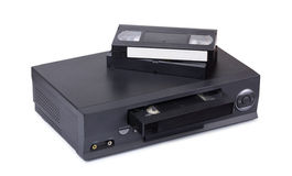 Old VHS video recorder and cassettes Royalty Free Stock Photos