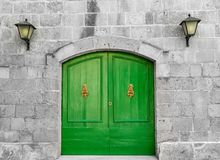 Old Vibrant Green Wooden Doors. Vintage green wooden traditional Maltese doors. Entrance into the old building built from limestone royalty free stock photo