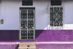 Old vibrant purple house facade. Front Of A Old Antique Traditional House With Vibrant Purple Facade stock photography