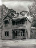 Old Victorian home. Historic double storey weatherboard home from pioneer days in Australia royalty free stock photo
