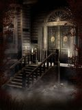 Old Victorian house. At night, with candles and ornamented door Royalty Free Stock Photo