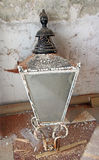 Old victorian lamp. Photo of an old crusty victorian lamp in need of renovation royalty free stock photos