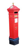 Old victorian post box. Bright red victorian post box against white background Stock Photo