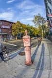 Old victorian sos telephone in Brooklyn, New York. NEW YORK, USA - OCT 21, 2015: typical street scene with people in early morning in New York, Brooklyn. An old royalty free stock image