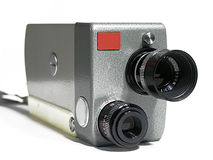 Old video camera. Old 16mm video camera on a white background Royalty Free Stock Photography