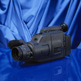 Old video camera. On blue background Royalty Free Stock Photos