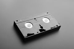 Old video cassette. Video cassette on the grey background royalty free stock photo