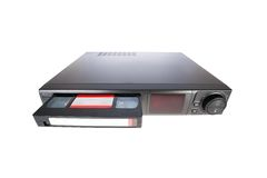 Old Video Cassette Recorder ejecting tape Stock Image
