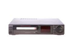 Old Video Cassette Recorder ejecting tape stock photography