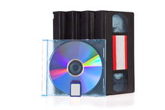 Old Video Cassette tape, with a DVD disc and Flash. Memory Card isolated on white background Royalty Free Stock Images