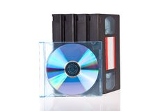 Old Video Cassette tapes with a DVD disc stock photo