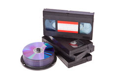 Old Video Cassette tapes with a DVD disc isolated. On white background Stock Photos