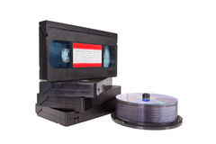 Old Video Cassette tapes with a DVD disc isolated royalty free stock images