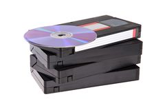 Old Video Cassette tapes with DVD discs. Isolated on white background Royalty Free Stock Photo