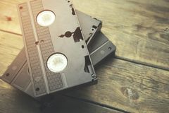 Old video tape. Old retro video tape over wooden background stock image