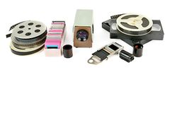 Old videocassettes and video projector with slides isolated on w. Hite background. Free space for text royalty free stock photography