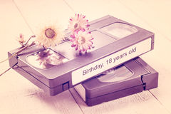 Old videotapes and dry flowers. Tinted photos Royalty Free Stock Images