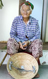 Old Vietnamese woman. Begging for people to throw money into her hat Royalty Free Stock Photography