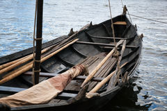 Old Viking boat. Old wooden boat with oars Royalty Free Stock Photo