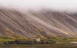 Old viking village in iceland with foggy hill. old wooden buildings covered in grass. Old viking village in iceland with foggy hill. old wooden buildings covered royalty free stock photo