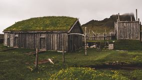 Old viking village in iceland with foggy hill. old wooden buildings covered in grass. Old viking village in iceland with foggy hill. old wooden buildings covered stock photos