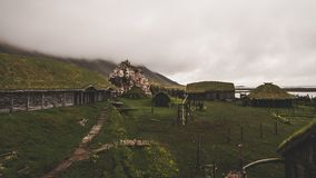 Old viking village in iceland with foggy hill. old wooden buildings covered in grass. Old viking village in iceland with foggy hill. old wooden buildings covered royalty free stock image