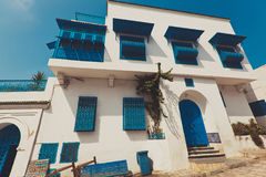 Old villa with blue forged door and windows stock image