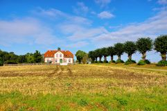 An old villa with a lime tree avenue on the island of Poel. In Germany stock photography