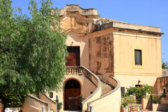 Old villa with spiral stairs. A picture of the exteriors of an old coral-coloured villa in Sicily, Italy Stock Photography