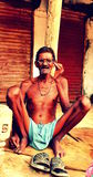 An old Indian village guy chilling after hard work Stock Photography