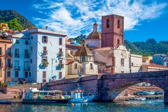 Old village of Bosa on the river Temo. In Sardinia, in a sunny and cloudy day, italy, town, sardegna, architecture, city, mediterranean, italian, house, travel royalty free stock image