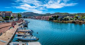 Old village of Bosa on the river Temo. In Sardinia, in a sunny and cloudy day, italy, town, sardegna, architecture, city, mediterranean, italian, house, travel stock photography