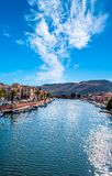 Old village of Bosa on the river Temo. In Sardinia, in a sunny and cloudy day, italy, town, sardegna, architecture, city, mediterranean, italian, house, travel stock photo