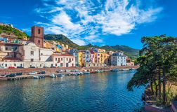 Old village of Bosa on the river Temo. In Sardinia, in a sunny and cloudy day, italy, town, sardegna, architecture, city, mediterranean, italian, house, travel stock photos