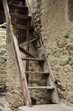 Old village broken wood ladder and stone wall Stock Photography