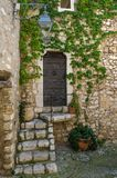 Old village doors with steps Royalty Free Stock Photo