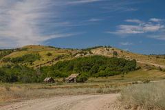 Old village. A hamlet in the hills far away from the city Royalty Free Stock Photo