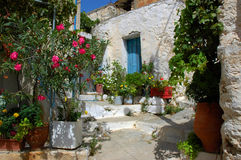 Old village house. Traditional old house surrounding with flowers Royalty Free Stock Image