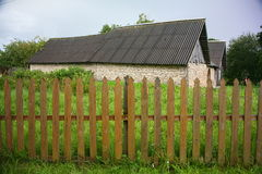 Old village house in the historical territory of the Northern Russian countryside. wooden fence. Stock Images