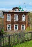 Old village house. Old rustic wooden house with two floors in the springtime Stock Image