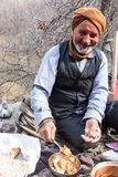 Old village man eats his lunch Royalty Free Stock Image