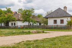 Old village, rural houses and road Royalty Free Stock Images