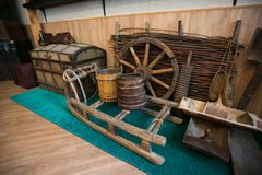 Old village spinning wheel in a junk shop royalty free stock image