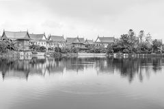 Old Village view with the reflection in the river. Royalty Free Stock Photography