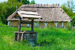 Old village well with a wood roof Stock Images